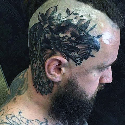 Tykk featherd Black Raven Tattoo On Mens Tonsured Head