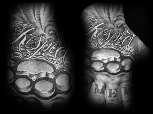 Szacunek Brass Knuckles Hand Tattoo On Guy