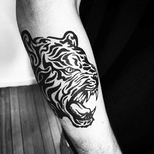 Guy With Tribal Outear Forearm Tiger Tattoo Design