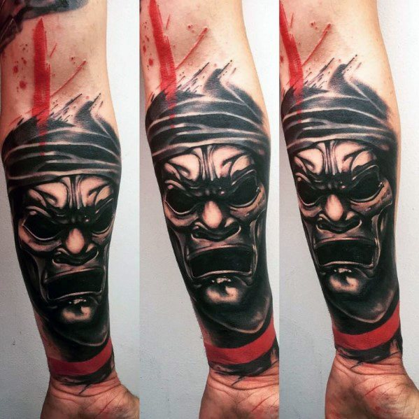 Distinctive Male Red And Black Tattoo Designs På Underarmen