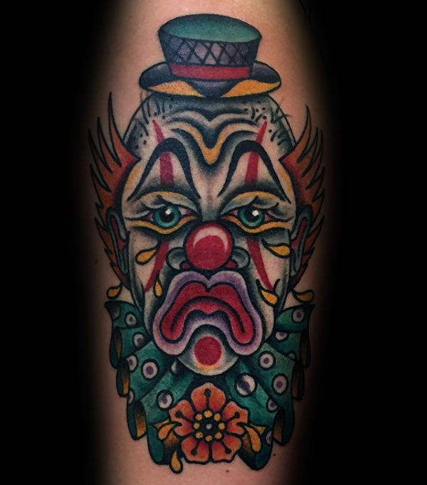 Traditionele trieste clown herenarm tatoeages