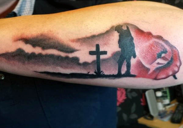 Manly Watercolor Poppy Solider Over Cross Grave Tattoo On Outer Forearm