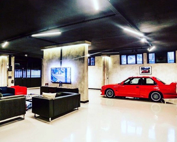 Man Gua Dream Garage Design With Black Ceiling And Lounge Area